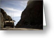 Driving Team Greeting Cards - A Mrap Vehicle Drives Greeting Card by Stocktrek Images