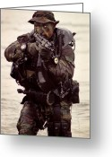 Firearms Photo Greeting Cards - A Navy Seal Exits The Water Armed Greeting Card by Michael Wood
