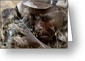 Laying Down Greeting Cards - A Nigerian Soldier Simulates Laying Greeting Card by Stocktrek Images