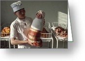Nurses Greeting Cards - A Nurse Holds A Tightly Wrapped Newborn Greeting Card by Dean Conger