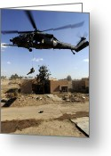Iraq Greeting Cards - A Pararescueman Rappels From An Hh-60 Greeting Card by Stocktrek Images