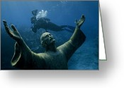 Southern States Greeting Cards - A Scuba Diver Swims Past The Statue Greeting Card by Bates Littlehales