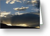 Wyoming Greeting Cards - A Silhouetted Figure Trail Running Greeting Card by Bobby Model
