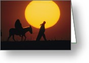 Domestic Scenes Greeting Cards - A Silhouetted Man Leads A Donkey Greeting Card by Thomas Nebbia
