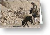 Military Police Greeting Cards - A Soldier And His Dog Search An Area Greeting Card by Stocktrek Images