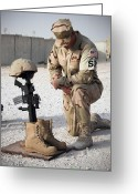 Bowing Greeting Cards - A Soldier Bows To Pay Tribute Greeting Card by Stocktrek Images