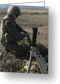 Gun Barrel Greeting Cards - A Soldier Changes The Barrel Of An M2 Greeting Card by Stocktrek Images