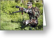 Battleground Greeting Cards - A Soldier Engages Hostile Forces Greeting Card by Stocktrek Images
