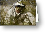 Camouflage Clothing Greeting Cards - A Soldier Practices Evasion Maneuvers Greeting Card by Stocktrek Images