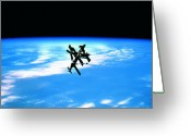 Space.planet Greeting Cards - A Space Station In Orbit Above Earth Greeting Card by Stockbyte
