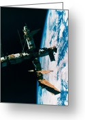 Space.planet Greeting Cards - A Space Station In Orbit Around The Earth Greeting Card by Stockbyte