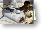 Iraq Greeting Cards - A Specialist Arms An F-16 Fighting Greeting Card by Stocktrek Images