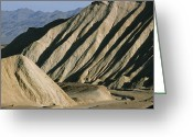 Driving Team Greeting Cards - A Truck Is Dwarfed By Eroded Desert Greeting Card by Gordon Wiltsie