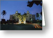 Of Buildings Greeting Cards - A Twilight View Of Building With Palm Greeting Card by Steve Winter