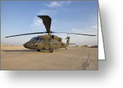 Iraq Greeting Cards - A Uh-60 Black Hawk Helicopter At Camp Greeting Card by Terry Moore