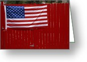 Wood Fences Greeting Cards - A United States Flag Hangs On A Bright Greeting Card by Raul Touzon