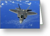 Fighter Jets Greeting Cards - A U.s. Air Force F-22 Raptor In Flight Greeting Card by Stocktrek Images