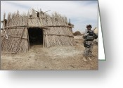 Outskirts Greeting Cards - A U.s. Soldier Provides Security Greeting Card by Stocktrek Images