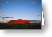 Rock Formations Greeting Cards - A View Of Ayers Rock Under A Twilight Greeting Card by Jason Edwards