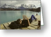 Hikers And Hiking Photo Greeting Cards - A Woman Relaxes On A Dock While Reading Greeting Card by Skip Brown