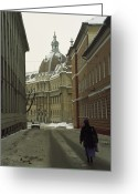 Exterior Buildings Greeting Cards - A Woman Walks Down A Snowy  Street Greeting Card by Gordon Wiltsie
