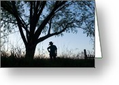 Cowboy Hat Photo Greeting Cards - A Young Boy Is Silhouetted Greeting Card by Joel Sartore
