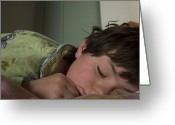 Pajamas Greeting Cards - A Young Boy Sleeps In Green Pajamas Greeting Card by Joel Sartore