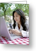 20-24 Years Greeting Cards - A Young Woman Checks Her Laptop Greeting Card by Justin Guariglia
