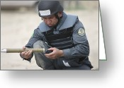 Police Officers Greeting Cards - Afghan Police Student Prepares Greeting Card by Terry Moore