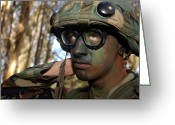 Camouflage Clothing Greeting Cards - Airman Applies Camouflage Make-up Greeting Card by Stocktrek Images