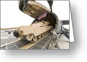 American Airmen Greeting Cards - Airmen Load A Tank Into A C-5m Super Greeting Card by Stocktrek Images