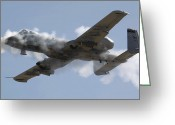 Airplane Greeting Cards - An A-10 Thunderbolt Ii Fires Its 30mm Greeting Card by Stocktrek Images