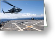 Gunship Greeting Cards - An Ah-1w Super Cobra Helicopter Lands Greeting Card by Stocktrek Images