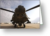 Agm-114 Greeting Cards - An Ah-64d Apache Longbow Block Iii Sits Greeting Card by Terry Moore