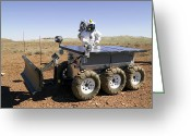 Desert Rats Greeting Cards - An Astronaut Drives An Electric Tractor Greeting Card by Stocktrek Images