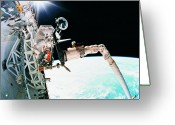 Space.planet Greeting Cards - An Astronaut Working In Space Greeting Card by Stockbyte