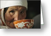 Headgear Greeting Cards - An Elderly Woman Drinks From A Cup Greeting Card by David Edwards