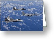 Fighter Jets Greeting Cards - An F-15 Eagle And Two F-22 Raptors Fly Greeting Card by HIGH-G Productions