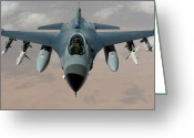 Air-to-air Greeting Cards - An F-16 Fighting Falcon Flies A Mission Greeting Card by Stocktrek Images