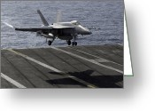 Aircraft Carrier Greeting Cards - An Fa-18e Super Hornet Prepares To Land Greeting Card by Stocktrek Images