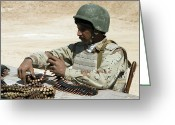 Iraqi Military Greeting Cards - An Iraqi Army Soldier Prepares Belts Greeting Card by Stocktrek Images