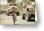 Tricks Greeting Cards - An Iraqi Boy Rides His Bike Past A U.s Greeting Card by Stocktrek Images