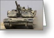 Battle Tanks Greeting Cards - An M1a1 Abrams Tank Heading Greeting Card by Stocktrek Images