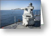 Gun Barrel Greeting Cards - An Mk-38 Machine Gun System Aboard Uss Greeting Card by Stocktrek Images