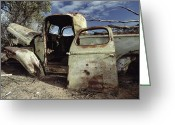 Environmental Damage Greeting Cards - An Old Wrecked Truck In A Desert Greeting Card by Jason Edwards