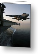 Aircraft Carrier Greeting Cards - An S-3b Viking Clears The Flight Deck Greeting Card by Stocktrek Images