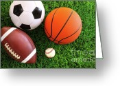 Football Photo Greeting Cards - Assortment of sport balls on grass Greeting Card by Sandra Cunningham