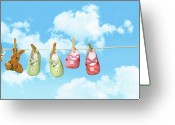 Clothesline Greeting Cards - Baby shoesr and teddy bear on clothline Greeting Card by Sandra Cunningham