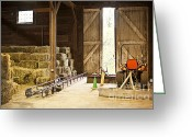 Indoors Greeting Cards - Barn with hay bales and farm equipment Greeting Card by Elena Elisseeva