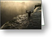 Humans Greeting Cards - Bathing In A Swimming Hole At The Top Greeting Card by Annie Griffiths